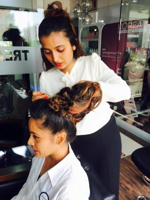 Nikisha Bhatia styling one of clients at Shyam's Salon