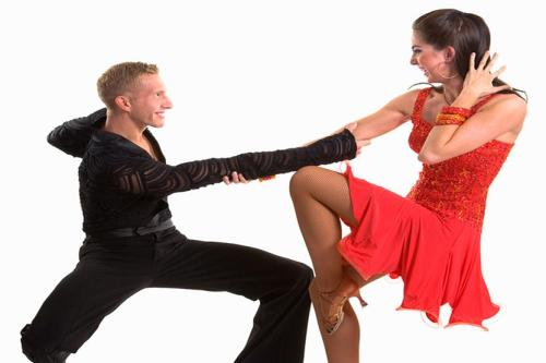 A couple depicting Merengue pose