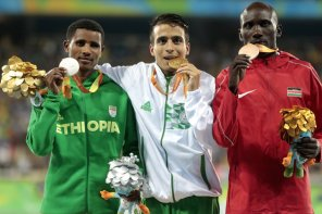 RIO DE JANEIRO, BRAZIL - SEPTEMBER 11: (L to R) Silver medalist Tamiru Demisse of Ethiopia , gold medalist Abdellatif Baka of Algeria and bronze medalist Henry Kirwa of Kenya celebrate on the podium at the medal ceremony for the Men's 1500m - T13 Final during day 4 of the Rio 2016 Paralympic Games at the Olympic Stadium on September 11, 2016 in Rio de Janeiro, Brazil. (Photo by Alexandre Loureiro/Getty Images)