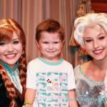 Anna and Elsa pose with Carson at the Princess Fairy Tale Hall at Magic Kindgom's Fantasyland.