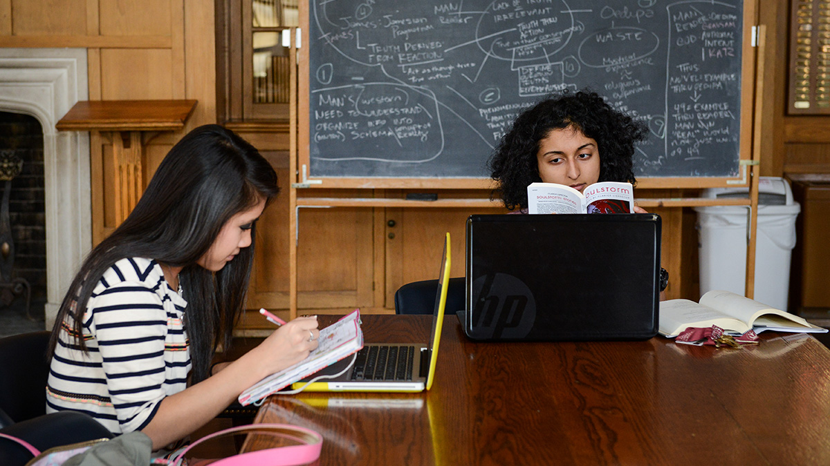 Honors students studying at wooden table