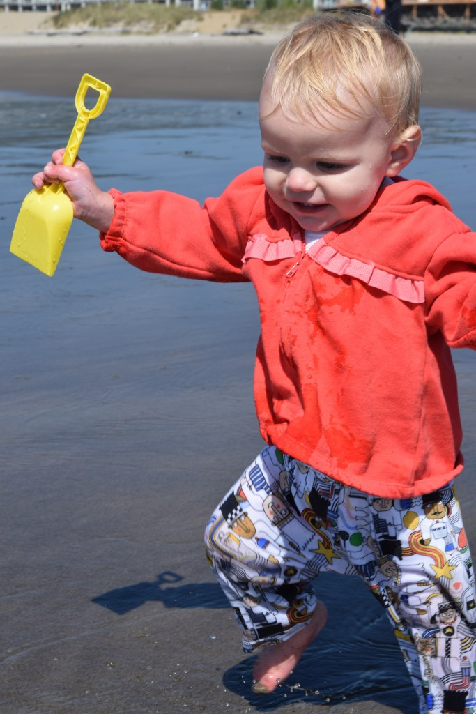 Now that she's mobile, the beach is even more fun for this toddler. Ten Thousand Hour Mama