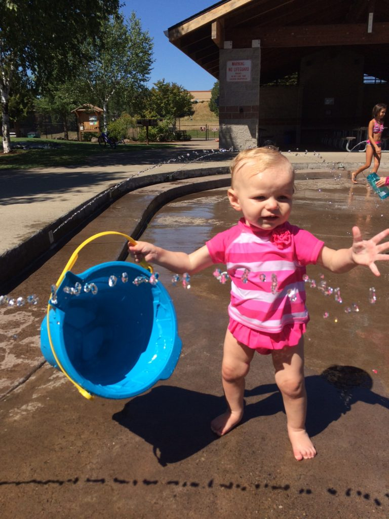Now that this toddler can walk, she loves the splash pad all summer long!