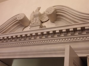 Eagle above doorway.