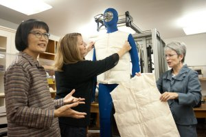 """Clothing designs get the sweat test. OSU professors Hsiou-Lien Chen, Brigitte Cluver and Leslie Burns test experimental fabrics and outdoor apparel on """"Newton,"""" a manikin that perspires through artificial pores. (Photo: Jeff Basinger)"""