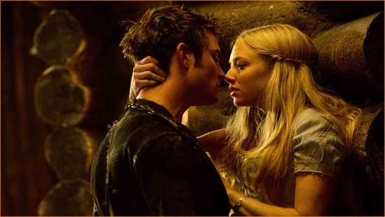 """Valerie (Amanda Seyfried) and Peter (Shiloh Fernandez) play Find the Lycanthrope in """"Red Riding Hood""""."""
