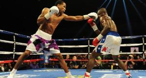 Peterson Retains Title, Charlo Decisions Rosado