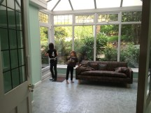E & O checking out the conservatory (with leftover couch we've moved out.)