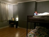J and Ben's room, minus a shelf/dresser on other side. (It's not really painted this dark.)