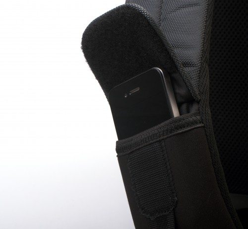 The strap pocket will just barely hold a naked iPhone 4/4s