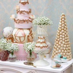Elegant sweet table with big cake and macaroon on dinner or event party