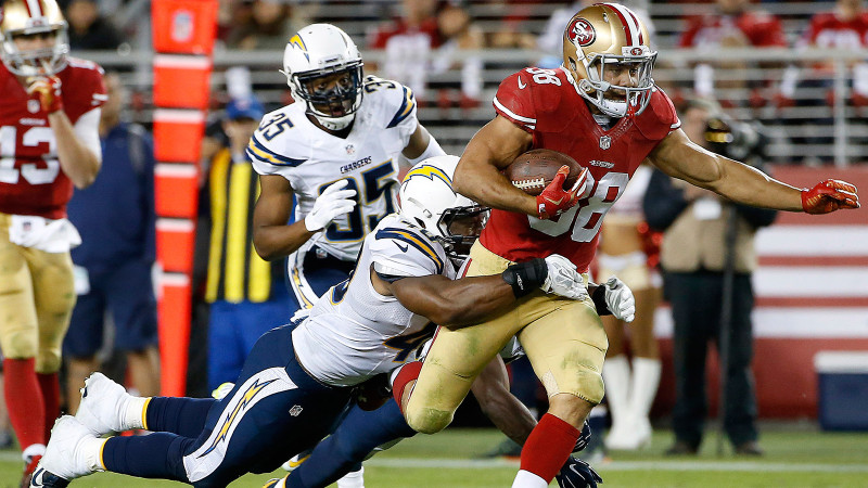 San Francisco 49ers running back Jarryd Hayne (38) runs past San Diego Chargers linebacker Chi Chi Ariguzo, bottom, cornerback Richard Crawford (35) and defensive back Adrian Phillips, rear, during the second half of an NFL preseason football game in Santa Clara, Calif., Thursday, Sept. 3, 2015. (AP Photo/Tony Avelar)