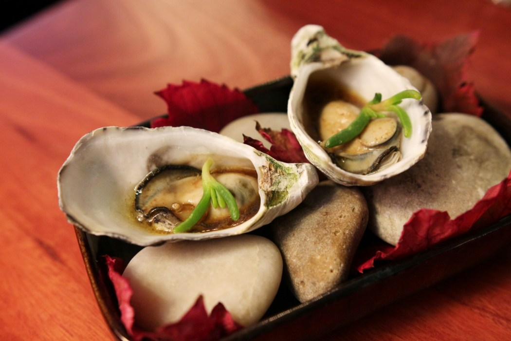 Cooked oysters with yuzu sauce at The Henry Austin