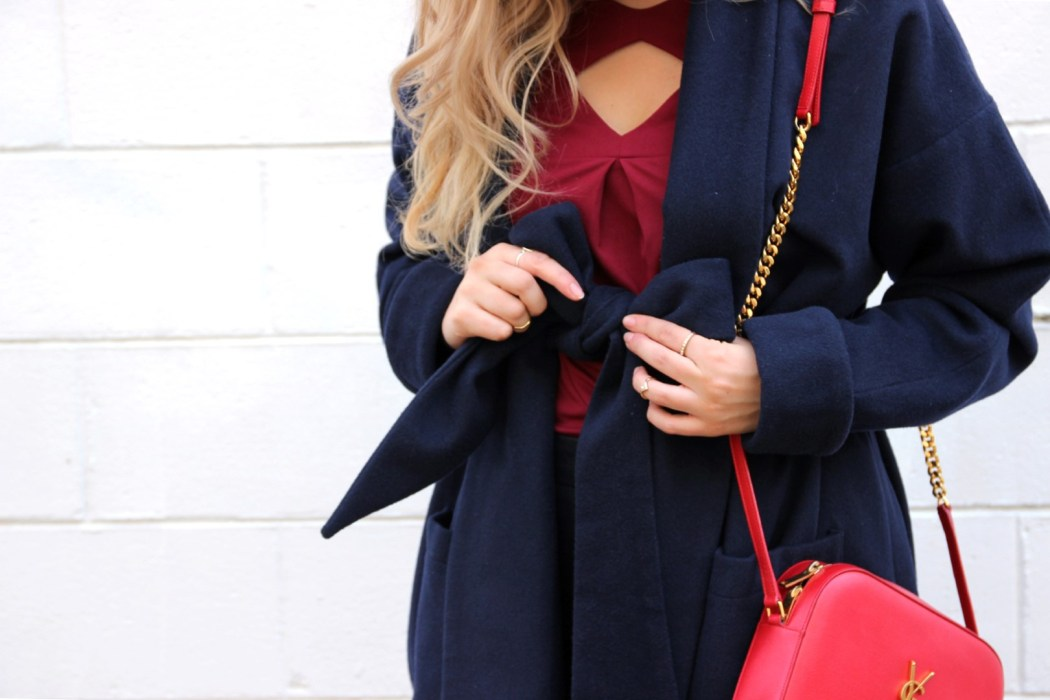 Mel wears Lucid Label's Robe Coat in Navy and Origami Jersey Cut-out Top in Maroon.