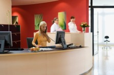 RECEPTIONIST WITH PASSING PEOPLE