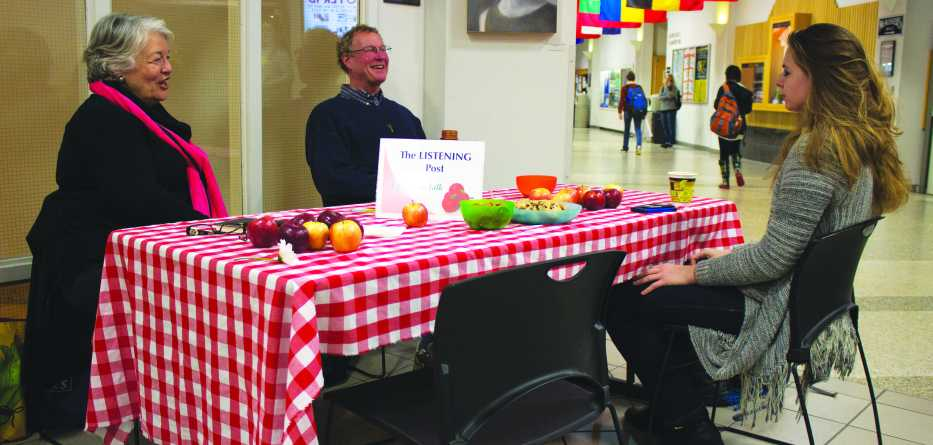Sophomore Adria West converses with Judy Lilly and Greg Erickson at the Listening Post in the Student Union. Photo by Dallas Linger.