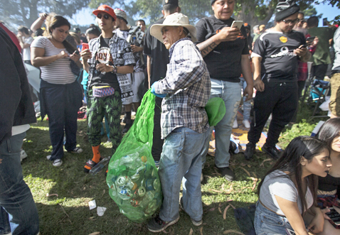 A man gathers heaps of recyclables during a 4/20 celebration at Golden Gate Park's Hippie Hill in San Francisco, Calif. Wednesday, April 20, 2016. (Jessica Christian/S.F. Examiner)