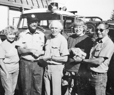 John Hulbert (R) with one of his many donations to the local fire department