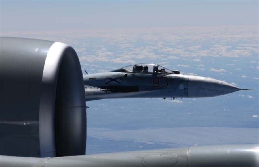 HERE ARE THE PHOTOS OF THE RECENT CLOSE CALL OVER THE BALTIC SEA BETWEEN A USAF RC-135U AND A RUSSIAN Su-27 FLANKER