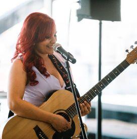 Amelia Singing Playing Guitar