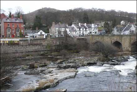 Bridge over river with rapids