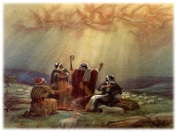 Shepherds with their sheep in a field heavenly light