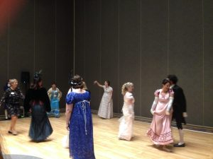 Photo of the Beau Monde Soirée as the dancers learn a Scottish Reel.