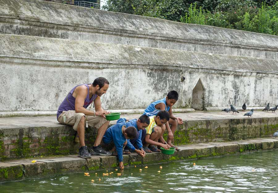 Feeding the fish with the young kids in Bhaktapur, Nepal