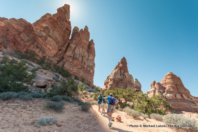 Hikers approaching Chesler Park, Canyonlands National Park.