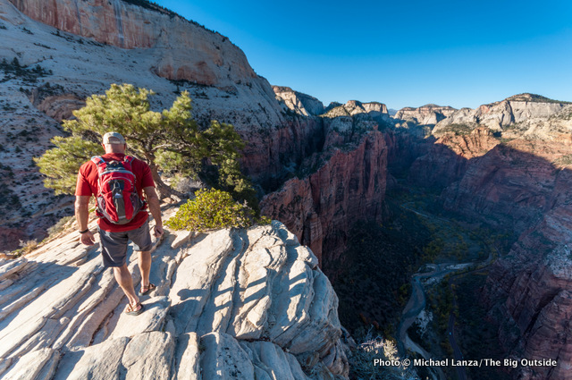 A hiker atop Angels Landing in Zion National Park.