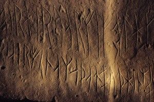 1990s, Near Stromness, Scotland, UK --- Engraved Viking runes on a stone in Maes Howe near Stromness in the Orkney Islands Area in Scotland. --- Image by © Homer Sykes/CORBIS