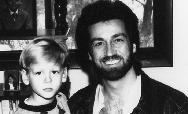 Lou Holly in the 1980s with his young son.
