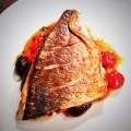 Bream fillet with tomato and olive salsa