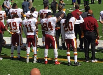 Dallas Cowboys' Owner Wants Players to Stand for National Anthem–Four Redskins Fist Salute it