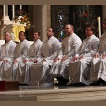 Eight men celebrate their ordination to the diaconate