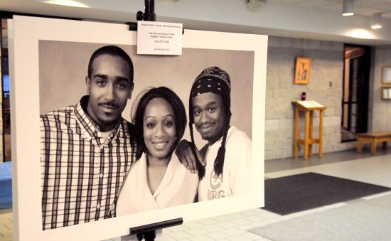 "This photo from the ""Homeless is My Address, Not My Name"" portrait exhibit at St. John Neumann in Eagan features ""Russell, Nicole and James"" of Minneapolis. It was taken by photographer Joey McLeister in 2010. Dianne Towalski / The Catholic Spirit"