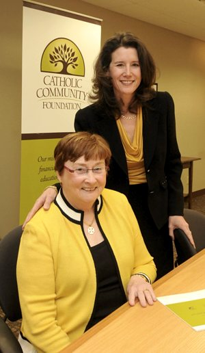 Catholic Community Foundation president Marilou Eldred, left, will retire April 30. Anne Cullen Miller will begin in that position May 1. Dianne Towalski / The Catholic Spirit