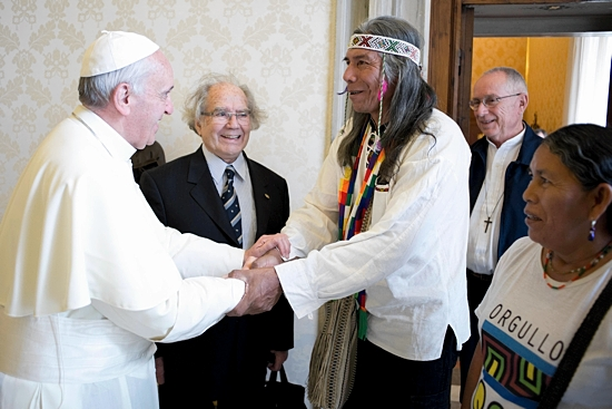 Pope Francis shakes hands with Felix Diaz, leader of the Northern Argentina Qom indigenous community, as Diaz's wife and Argentine Nobel Peace Prize laureate Adolfo Perez Esquivel, center, look on at during a private audience at the Vatican June 24. CNS photo/L'Osservatore Romano via Reuters