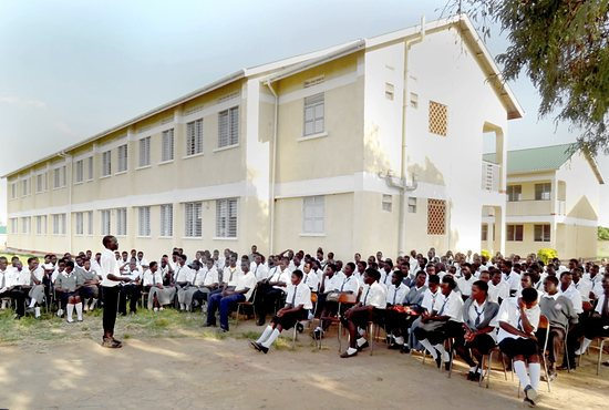 Students sit outside the Archbishop Flynn Secondary School in the Diocese of Gulu, Uganda. The school currently serves 352 students in four grade levels. Photo courtesy of John Desautels
