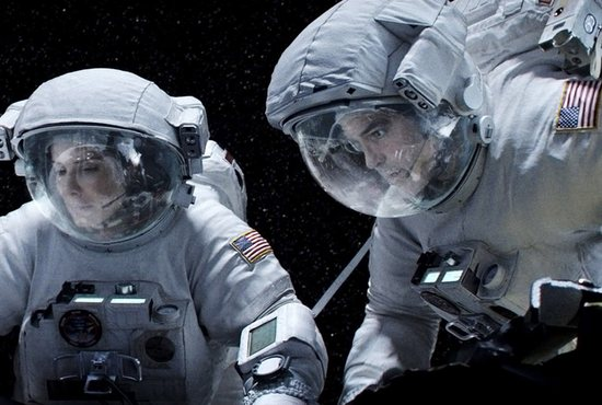 "Sandra Bullock and George Clooney star in a scene from the movie ""Gravity."" CNS photo/Warner Bros."
