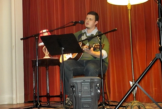 Benjamin Brekke performs his original Catholic-inspired music during a St. Mark's Acoustic Café event in October. Brekke started the quarterly event, which showcases five performances by Catholic musicians in a coffeehouse setting. Submitted photo/Joy Brekke