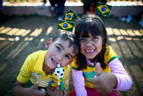Young Brazilian fans pose for a photo outside the Arena Corinthians stadium in Sao Paulo June 11. At the Vatican, Pope Francis told fans, players and organizers the World Cup should be a celebration of solidarity and peace. (CNS photo/Diego Azubel, EPA)