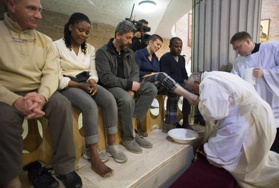 Pope Francis kisses the foot of a female inmate during the Holy Thursday Mass at Rebibbia prison in Rome in this April 2, 2015, file photo. Following a request by Pope Francis, the Vatican issued a decree Jan. 21 specifying that the Holy Thursday foot-washing ritual can include women. CNS photo/Reuters via L'Osservatore Romano