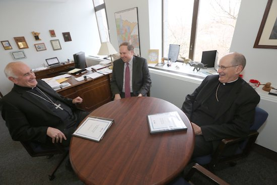 Bishops Donald Kettler of St. Cloud and John LeVoir of New Ulm meet with State Representative Jim Knoblach of St. Cloud in his office March 16. Dave Hrbacek / For The Visitor