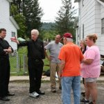 Bishop visits West Virginia's flood-ravaged areas, where recovery is ongoing