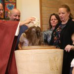Two sets of second-grade twins baptized at Columbia Heights school
