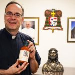 Priest uses his mother's sauce recipe to help the needy, evangelize