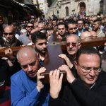 Family tradition: Carrying the cross on Jerusalem's Via Dolorosa