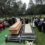 Archbishop laid to rest at Resurrection Cemetery