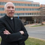 Priests get creative in ministering to COVID-19 patients at Twin Cities hospitals